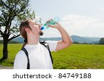 man drinking water in mountains | Shutterstock . vector #84749188