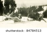 Vintage photo of family skying (forties) - stock photo