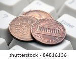 US coins on computer keyboard. Concept of e-commerce. - stock photo
