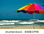 Brightly Colored Beach Umbrell...