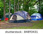 Camping Tents at Campground during Daytime in Woods - stock photo