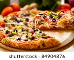 supreme pizza lifted slice | Shutterstock . vector #84904876