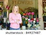 woman standing outside florist | Shutterstock . vector #84927487