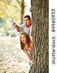 young couple behind tree... | Shutterstock . vector #84960955