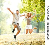 beautiful happy couple jumping... | Shutterstock . vector #84960973