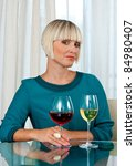 attractive woman with glasses of red and white wine - stock photo