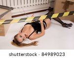 Crime scene simulation: dead blonde in the handcuffs lying on the floor - stock photo