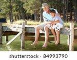 senior man fishing with grandson | Shutterstock . vector #84993790