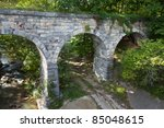 Side view of old stone bridge built in 1874 - stock photo