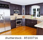 Stock photo modern domestic kitchen with new appliances and wooden floor 85103716