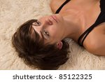 Lifeless pretty woman lying on the floor - stock photo