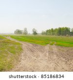 road in the field and blue sky - stock photo