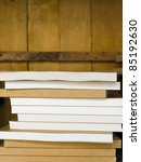 Brown sketch book stacked on wood shelf - stock photo