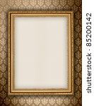 Golden frame on wallpaper background - stock photo