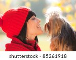 girl lovely look at small dog in her hands - stock photo