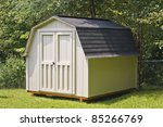 A Wood Utility Shed In A Back...