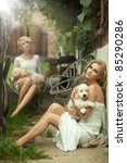 Perfect blonde beauties holding young dogs - stock photo