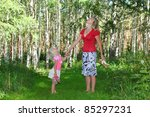 girl with mother in green forest | Shutterstock . vector #85297231