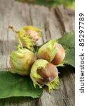Autumn still-life with hazelnuts on wooden background - stock photo