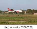 ROME, ITALY - SEPT 16: A Cimber Sertling airplane lands at the airport in Rome, Italy on Sept, 16 2011. The Danish airline operates domestic and international services in co-operation with Scandinavian Airlines. - stock photo