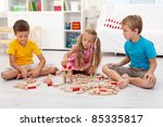 three kids playing with wooden... | Shutterstock . vector #85335817