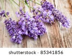 Still-life with lavender bunch on wooden background - stock photo