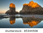 Reflections Of Rock Stacks On...