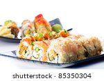 A diverse selection of delicious Japanese sushi rolls. - stock photo