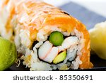 A Japanese seafood Sushi roll with fresh salmon seared rare, asparagus, wasabi and more. - stock photo