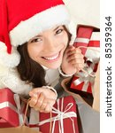 Christmas gift woman shopping wearing santa hat smiling happy. Closeup portrait of cute mixed race Caucasian Asian female model isolated on white background. - stock photo