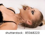 Crime scene simulation: pretty blonde in the handcuffs lying on the floor - stock photo