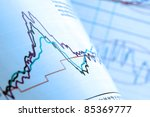 Analysing financial data on stocks and shares chart - stock photo