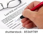 Close up of hand signing a Last Will and Testament document - stock photo