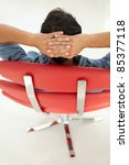 young man relaxing in red chair | Shutterstock . vector #85377118