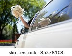 bride waving hand from car...