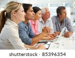 mixed group in business meeting | Shutterstock . vector #85396354