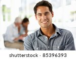 hispanic businessman in office | Shutterstock . vector #85396393