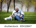 Stock photo man with jack russel terrier 85410847