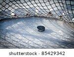 hockey net with puck in goal | Shutterstock . vector #85429342
