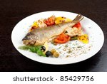 trout fish baked with pepper, string beans, tomato and cauliflower - stock photo