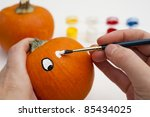 Painting The Eyes On A Pumpkin