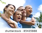 family of a four playing at... | Shutterstock . vector #85435888