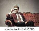 smiling elegant man sitting on... | Shutterstock . vector #85451686