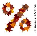 Percent symbol made with autumn leaves. Isolated on white background. - stock photo