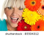 beauty portrait of young woman with flowers - stock photo