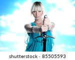 Fantasy woman with sword and cross in blue dress - stock photo