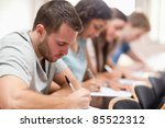 Serious Students Sitting For A...