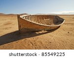 A Broken  Discarded Boat In Th...