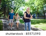 Stock photo group of students on their way to class walking through campus 85571593