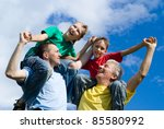 portrait of a cute family on a... | Shutterstock . vector #85580992